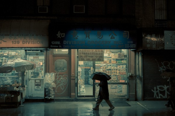 Umbrella man, Chinatown, Manhattan, NY, 2014