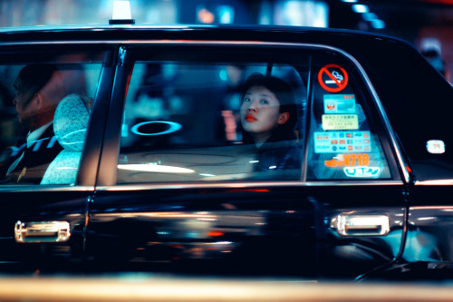 Asian girl in a car
